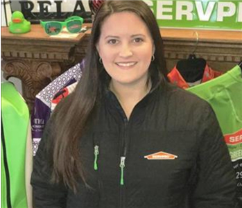 Office Manager, Holly Lee, standing in her SERVPRO gear.